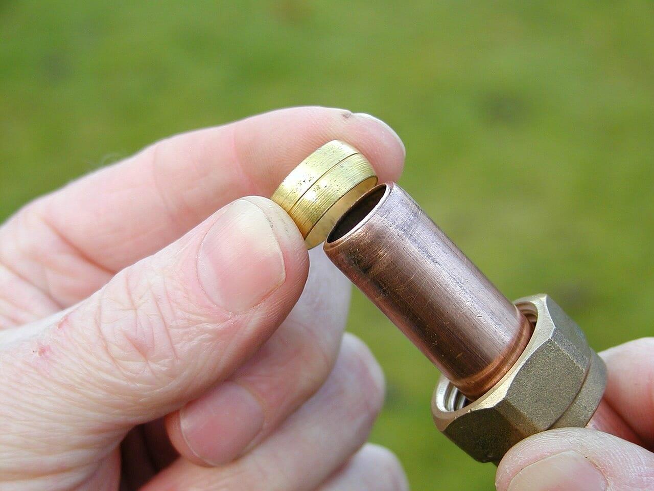 plumber using copper pipe